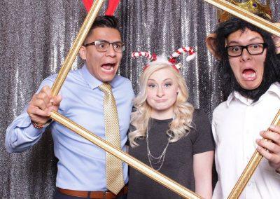 3 individuals posing in fun props