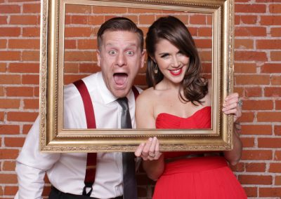 happy couples at party with picture frame